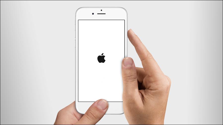 الايفون معلق على التفاحة ايفون 11 X على شعار ابل واعادة التشغيل مدينة التطبيقات